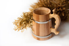 Wooden mug, rye and wheat Stock Images