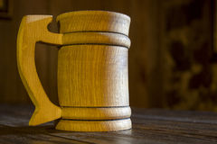 Wooden mug in a tavern Royalty Free Stock Image