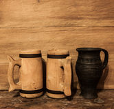 Wooden mugs and clay jug Royalty Free Stock Photography