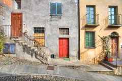 Wooden multicolored doors in the house in Saluzzo. Stock Photography