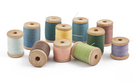 Wooden multicolored thread coils. On white background Stock Image