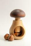 Wooden mushroom cracking nut. Wooden mushroom and cracked nut Royalty Free Stock Photo