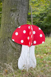 Wooden mushroom in forest Stock Photos