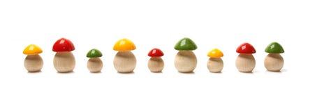 Wooden mushrooms. On white background Royalty Free Stock Photo