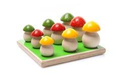Wooden mushrooms. On white background Stock Image