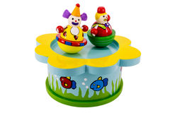 Wooden music box. Colorful wooden music box with white background and clowns Stock Images