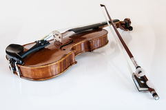 Wooden music violin with bow Royalty Free Stock Images
