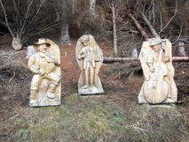 Wooden musicians. Musicians statues along the a path at dosoledo in italy royalty free stock photo