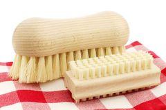 A wooden nail brush and a wooden household brush Royalty Free Stock Photos