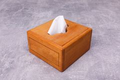 A wooden napkin holder stock images