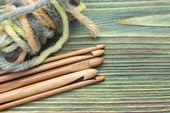 Free Wooden Natural Bamboo Crochet Hooks And Yarn Ball On The Green Table. Creative Work Place For Homemade Crafts. Top View, Place For Stock Photography - 100725352
