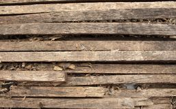 Wooden natural brown background with scars and patterns. Wooden slats. Burned Tree royalty free stock image