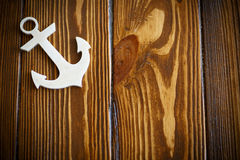 Wooden nautical anchor Stock Images