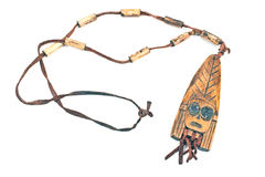 Wooden necklace with pendant of african woman Stock Images