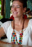 Wooden necklace worn by a cheerful young woman in Puerto Viejo, Costa Rica. Royalty Free Stock Photos