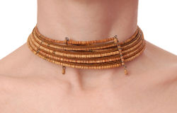 Wooden necklet is on female neck Stock Photos
