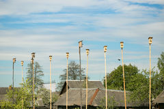 Wooden nesting boxes birdhouses on the blue sky bird`s hostel. A lot of bird houses on one tree.Community concept.Living space Royalty Free Stock Photo