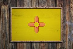 Wooden New Mexico flag. 3d rendering of a New Mexico State USA flag on a wooden frame and a wood wall Stock Photos