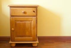 Wooden nightstand Stock Image