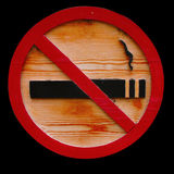 Wooden No Smoking Sign. On isolated black background Stock Images