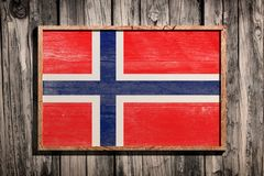 Wooden Norway flag. 3d rendering of Norway flag on a wooden frame over a planks wall royalty free stock photos