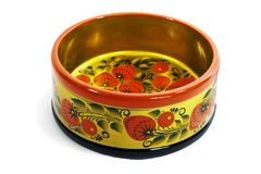 Wooden not deep bowl, painted in the style of Khokhloma Royalty Free Stock Photo
