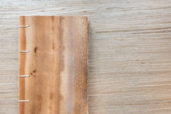 Wooden notebook on wooden background Stock Image