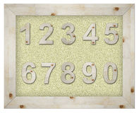 Wooden number on board Royalty Free Stock Photo