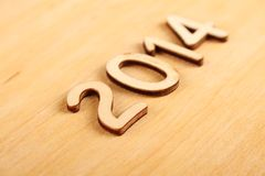 Wooden number in 2014. New Year. Wooden 2014. New year text on plank wood Stock Photo