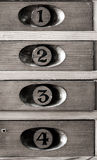 Wooden numbered museum cupboards Royalty Free Stock Image