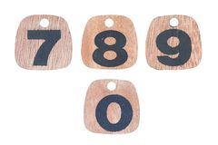 Wooden numbers 7 8 9 0 stock images