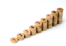 Wooden numbers diagram. Stacks of wooden numbers   like chart  diagram on  white background Royalty Free Stock Photo