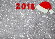 Wooden numbers forming the number 2018, For the new year and snow on a gray concrete background. Stock Photos