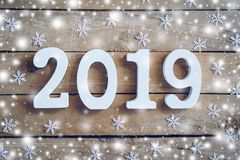 Wooden numbers forming the number 2019, For the new year and whi stock photos