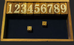 Wooden numbers game with two dices Royalty Free Stock Photography