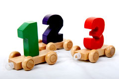 Wooden numbers one two three. Wooden educational toy train of number one two three on the wheels Stock Photography