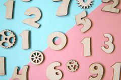 Wooden numbers on pastel colored background royalty free stock photography
