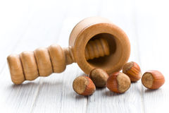 Wooden nutcracker and hazelnuts Royalty Free Stock Images