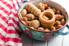 Wooden nutcracker and nuts Royalty Free Stock Image