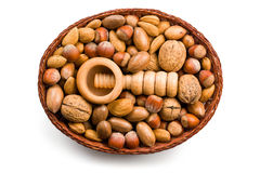 Wooden nutcracker and nuts in basket Royalty Free Stock Photography