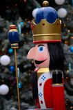 Wooden Nutcracker prince statue in colorful regalia from Christmas fairy tale story. Singapore - December 7, 2016: A wooden replica model statue of the Royalty Free Stock Images