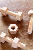 Wooden nuts and bolts Stock Photography