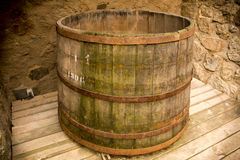 Wooden Oak Barrel. A nice capture of a wooden medieval oak barrel located in an old castle ruin royalty free stock images