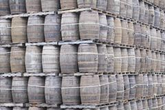 Wooden oak barrel stack for whisky distillery royalty free stock photography