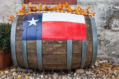 Wooden oak barrel with Texas flag painted on/ Decorative oak barrel in front of winery stock photography