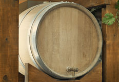 Wooden oak barrel wine,  with metal crane. . Royalty Free Stock Photo