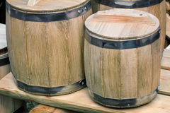 Wooden oak barrels for storing wine. Stock Photography