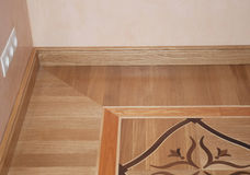 Wooden Oak Parquet Floor Texture Background. Closeup on  Baseboard Oak Wood Parquet Flooring Stock Photo