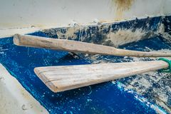 Wooden oars in old rowing boat. Wooden oars in an old, disused and abandoned rowing boat on the beach in Agios Nikolaos port in summer, Zante Island, Greece royalty free stock photo