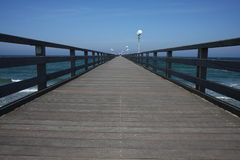 Wooden ocean-bridge. Wooden bridge into the ocean Royalty Free Stock Photos